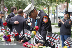 New York, 9.11 20th Anniversary Ceremony held at Ground Zero. Families and Friends gather to hear the names of the victims of the World Trade Center Attack. Families place flowers and photographs on the names of the victims.