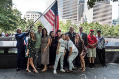 Family members of a 9/11 victim pose at the National 9/11 Memorial and Museum during the commemoration the 20th anniversary of the 9/11 attacks on the World Trade Center, in New York, on September 11, 2021