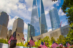 NEW YORK, NEW YORK - SEPTEMBER 11: Flowers are placed into the inscribed names of the victims of the 9/11 attacks and in the 1993 World Trade Center bombing during the annual commemoration ceremony at the National 9/11 Memorial and Museum on September 11, 2021 in New York City. The nation is marking the 20th anniversary of the terror attacks of September 11, 2001, when the terrorist group al-Qaeda flew hijacked airplanes into the World Trade Center, Shanksville, PA and the Pentagon, killing nearly 3,000 people
