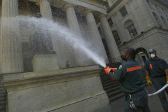 September 13, 2001--World Trade Center--NYC Sanitation workers hose debris off of the statue of George Washington on the steps of Federal Hall in Lower Manhattan on Thursday  September 13, 2001. (©2001 Kevin P. Coughlin/Independent Photojournalist)