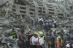 September 13, 2001--World Trade Center--Firefighters and rescue workers search for survivors through the rubble of the destroyed World Trade Center after terrorist attacks two days earlier on Tuesday September 11, 2001. (©2001 Kevin P. Coughlin/Independent Photojournalist)