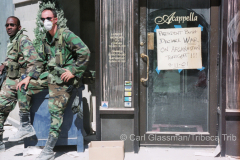 On 9/11/01, National Guradsman beside closed restaurant at Chambers Street and West Broadway.