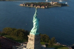 Aerial View of the Statue Of Liberty. The Statue of Liberty Museum opened to visitors last week with a limited capacity and tickets are required.The Crown and Pedestal interior areas will remain closed during this phase of the reopening. The gift shop and public restrooms are open. Food service is limited to outdoor dining only.