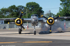 """Farmingdale, New York,  -- In preparation of Memorial Day Weekend, Farmingdale's American Airpower Museum (AAM) continues their historic participation in the Jones Beach Air Show, flying the Museum's fabled """"Arsenal of Democracy"""" warbirds over Jones Beach on Saturday, May 29th and Sunday, May 30th!  AAM's squadron of iconic and meticulously restored vintage military aircraft includes a B-25 Mitchell Bomber, Douglas C-47 Skytrain, Grumman TBM Avenger Torpedo Bomber, Curtiss P-40 Flying Tiger, P-51D Mustang Fighter, AT28D5 Nomad Vietnam Era Fighter and AT-6 Texan."""