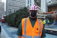 Arrival of the Rockerfeller Center Christmas Tree. Workers prepare the tree to be lifted into place as some of the family members watch the process. The whole family will be at the official tree lighting ceremony in December.Erik Pauze Head gardener at Rockerfeller Center