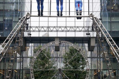 """The members of the STREB Extreme Action company perform up high in an experimental dance piece entitled """"Molinette"""" inside the public plaza of the Manhattan West Plaza at 395 9th Ave in Manhattan NY on September 17, 2021. (Photo by Andrew Schwartz)"""