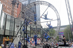 """The members of the STREB Extreme Action company perform on a giant rotating wheel in an experimental dance piece entitled """"Kaleidoscope"""" inside the public plaza of the Manhattan West Plaza at 395 9th Ave in Manhattan NY on September 17, 2021. (Photo by Andrew Schwartz)"""