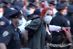 A Woman gets arrested during struggle with NYPD at the Barclay's protest.