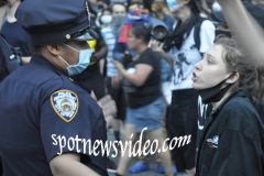As a patient cop listens, a young protester argues with an cop about life.