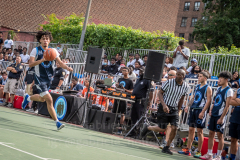 The Blue Chips basketball teams from the 111th (blue jersey) and 17th (white jersey) NYPD precincts compete for the championship title at Dyckmann Park. (Photo by Gabriele Holtermann)