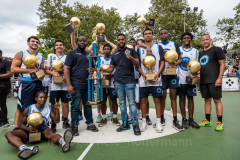 The Blue Chips basketball team from the 17th precinct celebrates its championship title. (Photo by Gabriele Holtermann)