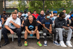 Players, coaches, and NYPD officers watch the Blue Chips basketball championship game between the 17th and 111th Precinct. (Photo by Gabriele Holtermann)