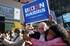 Celebrations breakout all over New York City with the news of  Biden/ Harris  Presidential victory.United States Senator Charles Schumer holds Biden / Harris sign while walking thru Times Square
