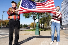 Two people hold the America flag for passerby's along the West Side Highway in New York to celebrate the news that Joe Biden will be the 46th President of The United States.