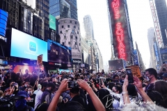 People gather in Times Square to celebrate the presidential election results that Joe Biden has defeated incumbent President Donald Trump.