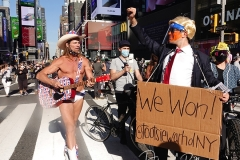 The Naked Cowboy and artist and activist Tootsie Warhol celebrate in Times Square the news that Joe Biden will be the 46th President of The United States.