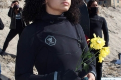 NEW YORK -  Black Surfers Association have a paddle out to honor George Floyd and Daunte Wright in Far Rockaway Queens at Beach 91st. Street. Surfers take to the water hold a prayer circle and place flowers in the water while family members and friends hold signs on the beach.
