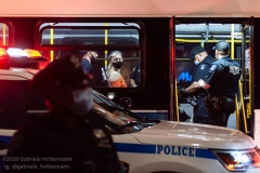 A demonstrator waits in an MTA bus after her arrest by the NYPD after protests over the death of George Floyd at the Barclays Center turned violent on May 30, 2020, in Brooklyn, New York. (Photo by Gabriele Holtermann)