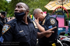An NYPD officer assists his collegue after a pepper spray incident at the Queer Liberation March in New York City, NY, on June 28, 2020. (Photo by Gabriele Holtermann/Sipa USA)