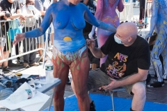 7th Annual Human Arts Connection Body Painting Day. The group paints human canvasses all over the world and painted people today in Times Square, New York City, while Social Distancing on 25 July 2020.