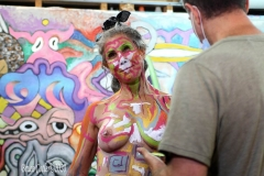 Breast Cancer Survivor Heidi Beri age 53 decided to get body painted to celebrate her survival. Heidi's boyfriend Eric Johnson contacted Artist and executive director of Human Connection Arts Andy Golub to paint her.