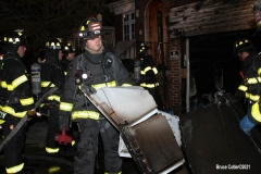 New York City. FDNY personnel extinguish a garage fire on East 29th Street and Kings Highway.