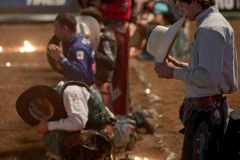 PBR Bull Riders pause for prayer before competing in the PBR's (Professional Bull Riders) Elite Unleash The Beast event at the Prudential Center in Newark NJ on September 19, 2021. (Photo by Andrew Schwartz)