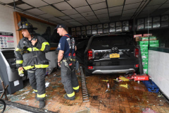 No drive through: A driver of a Hyundai Palisade lost control of his vehicle Monday morning at about 9 a.m. and crashed through the New Lin Wang Chinese-Thai restaurant on Avenue L in Canarsie Brooklyn. The two people in the car refused medical attention after the crash and luckily, New Lin Wang doesn't serve breakfast. (Photo by Todd Maisel)