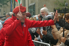"""Republican mayoral candidate Curtis Sliwa """"high fives"""" a spectator along the parade route."""