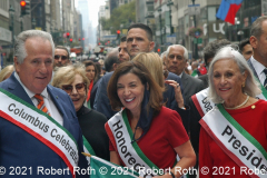 Gov. Kathy Hochul marches along with Columbus Day Parade officials.