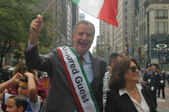 Mayor Bill de Blasio joined in the parade despite facing backlash over his decision to rename the school holiday Indigenous Peoples' Day.