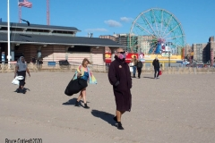 Coney Island Brooklyn. The Coney Island Polar Bear Club jumped into the Atlantic Ocean for their weekly swim. The air temperature was 37 degrees while the water temperature was 43 degrees, Onlookers were bundled up from the wind and cold.