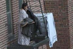 Woman picks up laundry that she put out earlier in the day.   8/9/2020