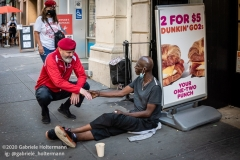 Curtis Sliwa, founder of the Guardian Angels, speaks to an unsheltered man while patroling the Upper West Side in New York City on August 9, 2020.  The neighborhood has experienced an uptick in crime and drugs after hotels have been turned into homeless shelters. (Photo by Gabriele Holtermann)