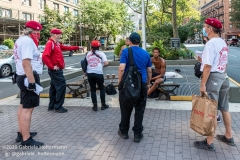 Curtis Sliwa, founder of the Guardian Angels, and his crew speak to a group of  unsheltered men while patroling the Upper West Side in New York City on August 9, 2020.  The neighborhood has experienced an uptick in crime and drugs after hotels have been turned into homeless shelters. (Photo by Gabriele Holtermann)