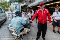 Curtis Sliwa, founder of the Guardian Angels, greets to a street vendor while patroling the  Upper West Side in New York City on August 9, 2020. Residents have complained about an uptick in crime and drugs as well as the housing of sexual offenders in the neighborhood after hotels in the neighborhood have been turned into homeless shelters. (Photo by Gabriele Holtermann)