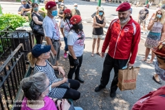 Curtis Sliwa, founder of the Guardian Angels, talks to two women before addressing Upper West Siders aboout the hotels turned homeless shelters in New York City on August 9, 2020. Residents have complained about an uptick in crime and drugs as well as the housing of sexual offenders in the neighborhood.(Photo by Gabriele Holtermann)