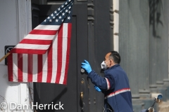 Mar 19, 2020:  COVID 19, the novel Coronavirus hits the Big Apple: A U.S. Postal worker wearing  a protective face mask in Tribeca, New York.