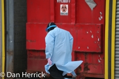Wyckoff Heights Medical Center is filled with COVID-19 or novel Coronavirus patients. A Hospital worker passes by a Biohazardous waste dumpster outside.