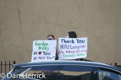 At 7PM Two girls greet  medical workers from NYU Langone as they came out to be greeted by applause at 7PM