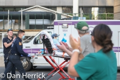 A patient arriving at NYU Langone during the 7pm Applause for Health Care Workers,