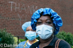 A 7pm Health Care Workers came outside  of Lenox Hill Hospital on the Upper East Side to be greeted by cheering from neighbors and passersby for their efforts in caring for Coronavirus / COVID-19 patients.  Portrait of a healthcare worker.