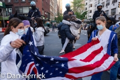A 7pm Health Care Workers came outside  of Lenox Hill Hospital on the Upper East Side to be greeted by cheering from neighbors and passersby for their efforts in caring for Coronavirus / COVID-19 patients. Medical Care workers folding the US Flag.