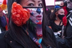 Day of The Dead and Black Lives Matters participants march through Times Square.