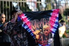 A fan of DMX holds a shirt during a funeral procession at Christian Cultural Center in the borough of Brooklyn, New York.