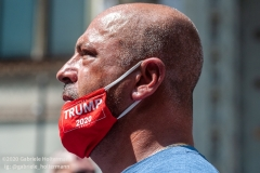 "A man with a Trump 2020 face mask attends  the ""Don't Give Up the Ship"" rally outside City Hall Park in New York City on August 22, 2020. The rally, led by Staten Island based artist Scott LoBaido, called out the Mayor's failure addressing the recent spike in gun violence and increase in homeless encampments. (Photo by Gabriele Holtermann)Holtermann/Sipa USA)"