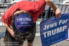 """A Jewish man wears a Trump yamaka and holds a sign """"Jew For Trump"""" at  the """"Don't Give Up the Ship"""" rally outside City Hall Park in New York City on August 22, 2020. The rally, led by Staten Island based artist Scott LoBaido, called out the Mayor's failure addressing the recent spike in gun violence and increase in homeless encampments. (Photo by Gabriele Holtermann)"""