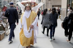 Participants march in the 2021 Annual Easter Bonnet Parade on Fifth Avenue in New York City on April 4, 2021. Paradegoers either dressed in their finest clothing or in colorful bonnets of all shapes and sizes still attended the annual Easter holiday tradition, on the steps of St. Patrick's Cathedral or in nearby Rockefeller Center, despite the Covid 19 pandemic. A man dressed as Jesus walks along Fifth Avenue. (Photo by Andrew Schwartz)