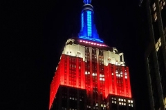 Election night in New York City. The Empire State Building is lit up in Red, White and Blue  for the presidential election.