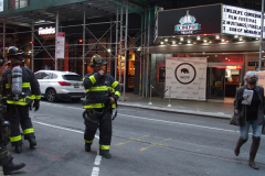 A fire broke out on the scaffolding of the iconic Cinema Village theater during the Wildlife Conservation Film Festival, on Saturday, October 16th in the West Village, NYC.  The building which once housed a firehouse at the turn of the 20th century, had smoke bellowing from the top when a guest noticed. FDNY found that possible cigarette butt thrown from above could be the possible culprit. Fortunately, no damage was done. (C) Bianca Otero, NYC, October 16, 2021.
